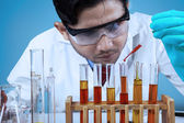 Scientist combining the chemical fluid — Stock Photo
