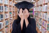 Student with graduation gown peeking — Stock Photo