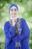 Thoughtful muslim woman with bokeh background — Stock Photo