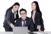 Three corporate workers with laptop isolated — Stock Photo