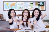 Teenager students shows thumbs up in class — Stock Photo