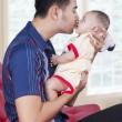 Sweet baby with dad on sofa at home — Stock Photo #78967700