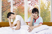 Asian couple after quarreling in bedroom — Stock Photo