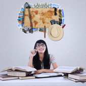 Female student imagine famous vacation place — Stock Photo