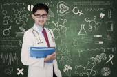 Medical student in classrom — Stock Photo