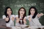 Excited schoolgirls showing OK sign — Stock Photo