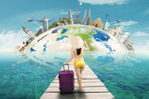 Woman with bikini holiday to the world monuments — Stock Photo