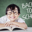 Cute little girl back to school and smiling — Stock Photo #80220258