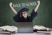 Excited student with mortarboard back to school — Stock Photo