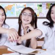 Cheerful high school students joining hands — Stock Photo #80734174