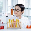 Cute boy doing chemical research in the lab — Stock Photo #80734296