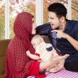 Man scolding his wife while holding baby — Stock Photo #80735028