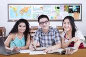 Friendly multi ethnic students studying in the class — Stock Photo