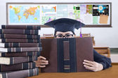 Graduate student cover her face with book — Stock Photo