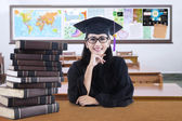 Graduate student sitting and smiling in the class — Stock Photo
