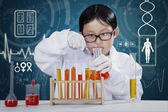 Little boy at chemistry lesson making experiments — Stock Photo