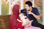 Man scolding his wife while holding baby — Stock Photo