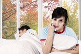 Woman crying in bedroom after quarrel — Stock Photo