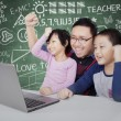 Successful students with their teacher raise hands — Stock Photo #81405330