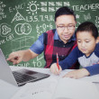 Teacher guides his male student to study — Stock Photo #81405418