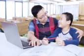 Clever student talking with his teacher in class — Stock Photo