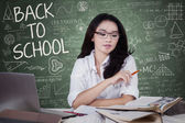Female high school student learning in class — Stock Photo