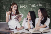Girls back to school and studying togehter — Stock Photo
