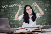 Happy student celebrate back to school in class — Stock Photo