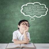 Primary school student thinking future jobs — Stock Photo