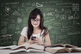 Student texting in the class — Stock Photo