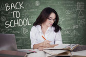 Young girl back to school and learn in class — Stock Photo