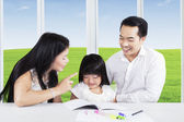 Mother scolding her child for doing homework — Stock Photo