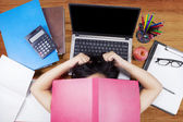 Frustrated female college student studying — Stock Photo
