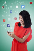 Happy woman enjoy social network on cellphone — Stock Photo