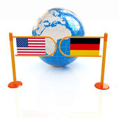 Three-dimensional image of the turnstile and flags of USA and Ge — Stock Photo