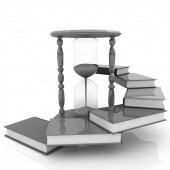 Hourglass and books — Stock Photo