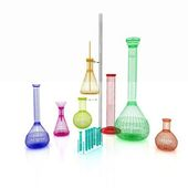 Chemistry set, with test tubes, and beakers filled with colored  — Stock Photo
