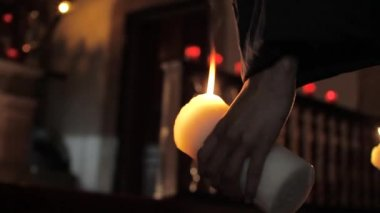 Believer holding a candle — Stock Video