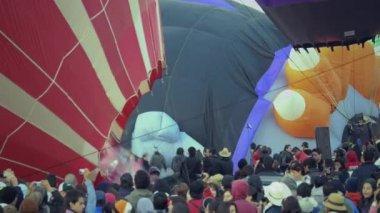 Spectators watching hot air balloons — Stock video