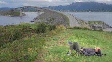 Man relaxing close to atlantic road — Stock Video