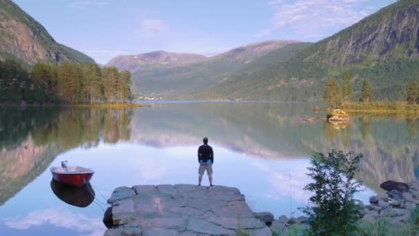 Man observing the tranquility of the lake — Vidéo