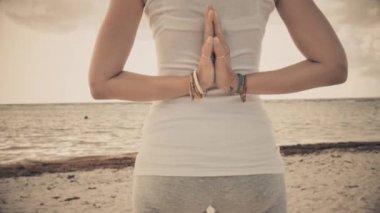 Woman in reverse prayer yoga pose — Stock Video