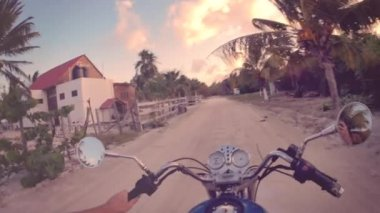 Ridding motorcycle in the caribbean — Stock Video