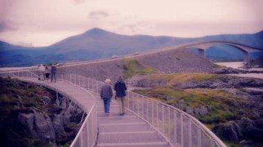 People walking on a bridge — ストックビデオ