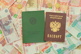 Russian passport and employment history are on the Russian money — Stock Photo