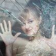 Girl behind the broken glass potreskanym — Stock Photo #65732809