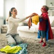 Little superhero helping his mother — Stockfoto #51811973