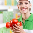 Sales clerk with fresh tomatoes — Stock Photo #51817499