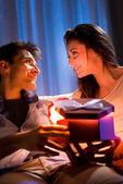 Romantic couple with present — Stock Photo