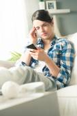 Woman with headache at home — Stock Photo